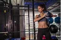 """<p>""""Medicine ball slams are a dynamic, explosive, and highly metabolic exercise that does not simply target one muscle group,"""" explains Chris DiVecchio, trainer and founder of <a href=""""https://www.pmblife.com/"""" rel=""""nofollow noopener"""" target=""""_blank"""" data-ylk=""""slk:Premier Body & Mind"""" class=""""link rapid-noclick-resp"""">Premier Body & Mind</a>. On the surface, the obliques, hamstrings, quads, biceps, and shoulders are the primary movers of this exercise. """"But as time goes on and fatigue sets in, nearly every other muscle in the body, in one way or another, may become involved as a secondary mover which makes this a total gut blaster,"""" he adds. Doing side-to-side ball slams versus overhead slams incorporates more oblique ab work.</p><p><strong>How to do lateral medicine ball slams: </strong>Stand with your feet about shoulder-width apart with the medicine ball on one side. Pick up the ball and simply rotate your body as you slam the ball a few inches away from your pinky toe. Make sure to pivot your feet and bend the back knee as you come into a split squat position to catch the ball on one bounce. Alternate sides. Make sure you tighten your core as you bring the ball overhead and to the side. </p>"""