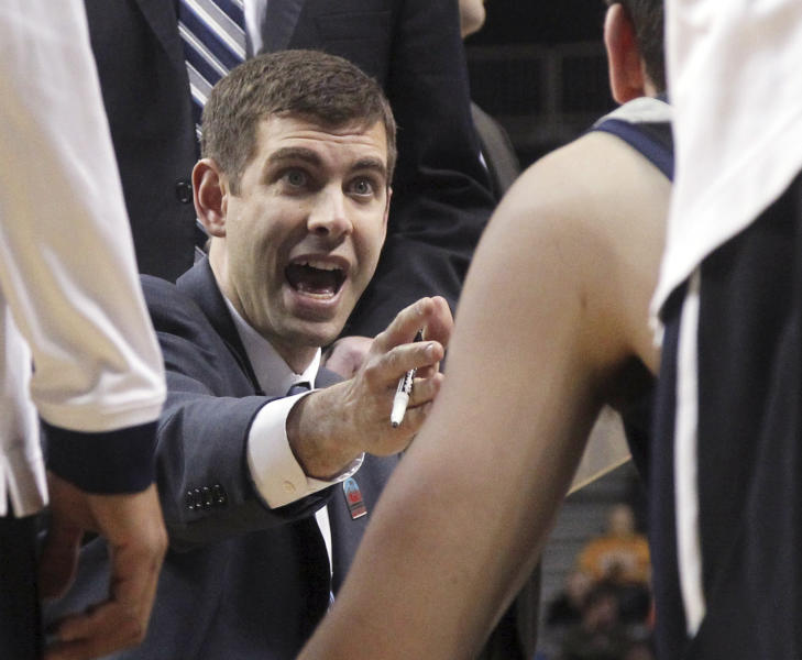 FILE - In this March 15, 2013 file photo, Butler coach Brad Stevens gives his team instruction during a timeout in the first half of an NCAA college basketball game against La Salle at the Atlantic 10 Conference tournament in New York. The Boston Celtics announced Wednesday, July 3, 2013, that Stevens was hired as the team's head coach, replacing Doc Rivers, who was traded to the Los Angeles Clippers. (AP Photo/Mary Altaffer, File)