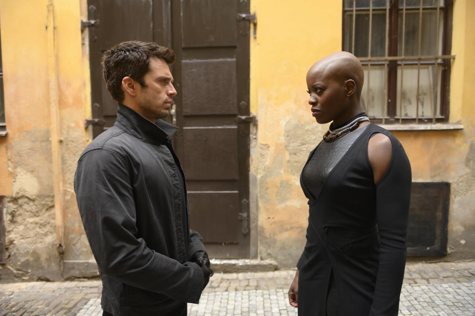 (L-R): Winter Soldier/Bucky Barnes (Sebastian Stan) and Ayo (Florence Kasumba) in Marvel Studios' THE FALCON AND THE WINTER SOLDIER exclusively on Disney+. Photo by Julie Vrabelová. ©Marvel Studios 2021. All Rights Reserved.