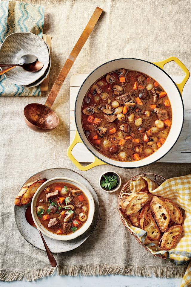 """<p><b>Recipe: </b><a href=""""https://www.southernliving.com/recipes/beef-stew-buttery-garlic-bread-recipe""""><b>Beef Stew with Buttery Garlic Bread</b></a></p> <p>Nothing welcomes cooler temps better than a warm bowl of <a href=""""https://www.southernliving.com/dish/stew/beef-stew-recipes"""">beef stew</a>. Crunchy, buttery garlic bread is essential for soaking up every last drop.</p>"""