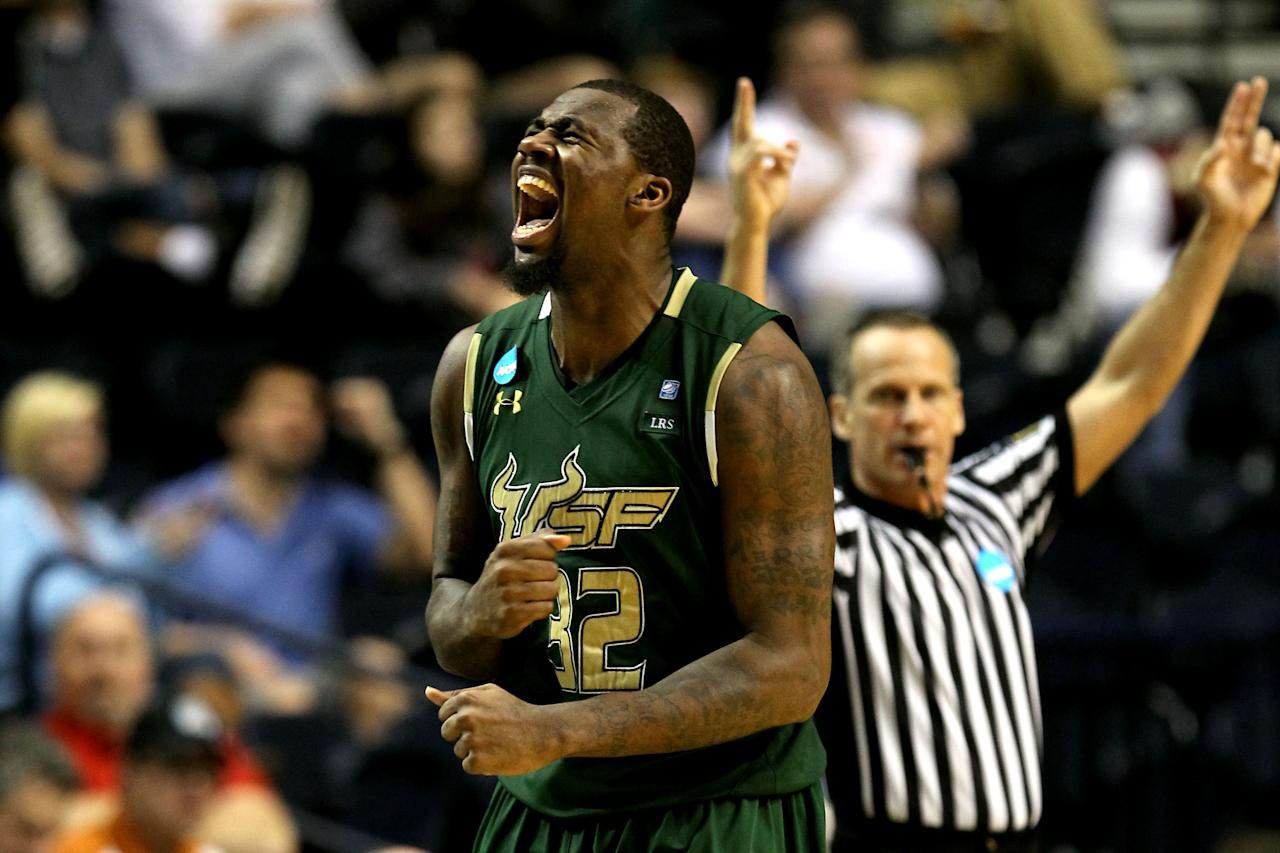 NASHVILLE, TN - MARCH 16:  Toarlyn Fitzpatrick #32 of the South Florida Bulls celebrates after a play against the Temple Owls during the second round of the 2012 NCAA Men's Basketball Tournament at Bridgestone Arena on March 16, 2012 in Nashville, Tennessee.  (Photo by Jamie Squire/Getty Images)