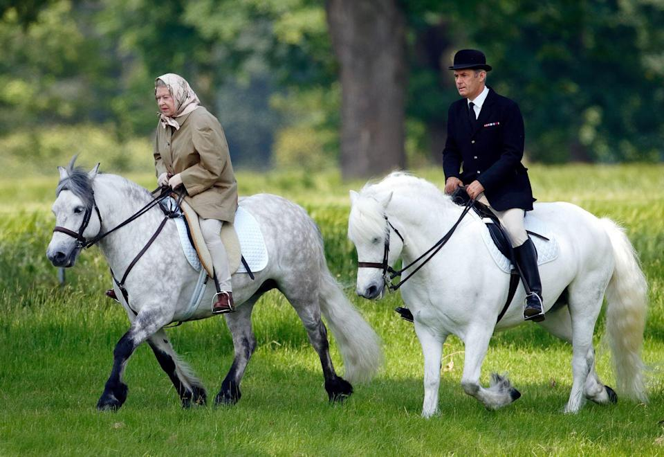 """<p>As an avid horseback rider, it isn't rare for the Queen to enjoy a ride in the saddle — <a href=""""https://www.usatoday.com/story/entertainment/celebrities/2020/05/31/queen-elizabeth-rides-horse-emerges-coronavirus-quarantine-windsor-castle/5301424002/"""" rel=""""nofollow noopener"""" target=""""_blank"""" data-ylk=""""slk:even at the age of 96"""" class=""""link rapid-noclick-resp"""">even at the age of 96</a>. At the end of the day, she's just your normal horse lover. Here, she rides at Windsor Castle in 2006. </p>"""
