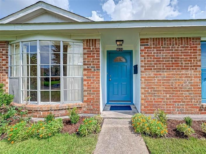 a close up of the blue door on a house for sale in houston