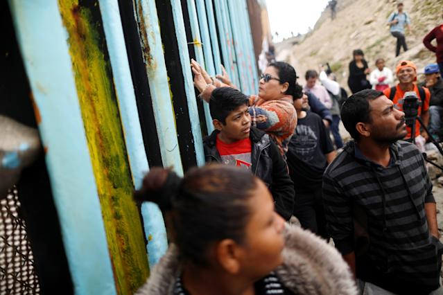 <p>Members of a caravan of migrants from Central America gather at the border fence between Mexico and the U.S. as part of a demonstration, prior to preparations for an asylum request in the U.S., in Tijuana, Mexico April 29, 2018. (Photo: Edgard Garrido/Reuters) </p>