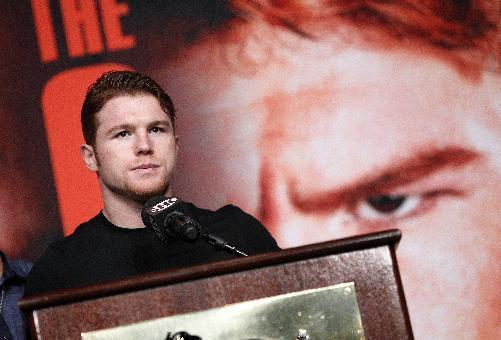 Boxer Carnelo Alvarez speaks during a press conference in Las Vegas, Wednesday, Sept. 11, 2013. Alvarez is scheduled to fight on Saturday against Floyd Mayweather, for Mayweather's WBA Super World and Alvarez's WBC junior middleweight titles. (AP Photo/Las Vegas Review-Journal, John Locher)