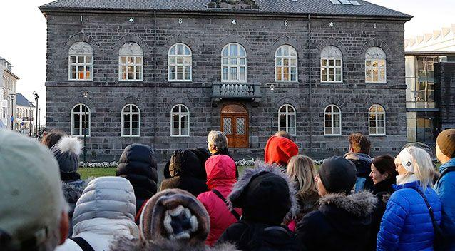 Supporters outside the Icelandic Parliament on March 8, 2017, the day the equal pay bill was passed. Source: AAP