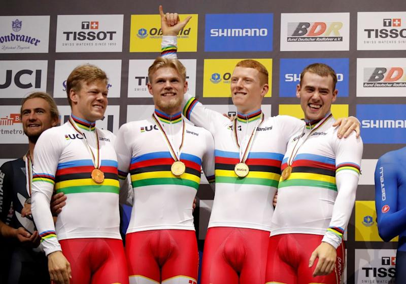 Winners Denmarks Lasse Norman Hansen Julius Johansen Frederik Rodenberg Madsen and Rasmus Pedersen pose with their medals on the podium after the mens Team Pursuit Finals at the UCI track cycling World Championship at the velodrome in Berlin on February 27 2020 Photo by Odd ANDERSEN AFP Photo by ODD ANDERSENAFP via Getty Images