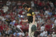 San Diego Padres starting pitcher Yu Darvish tosses a ball on the mound during the fourth inning of a baseball game against the St. Louis Cardinals Saturday, Sept. 18, 2021, in St. Louis. (AP Photo/Jeff Roberson)