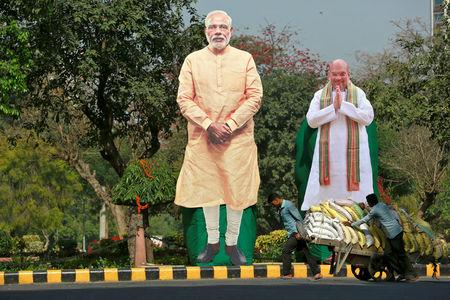 Giant cardboard cut outs of Indian Prime Minister Narendra Modi and Bharatiya Janata Party president Amit Shah are displayed in New Delhi