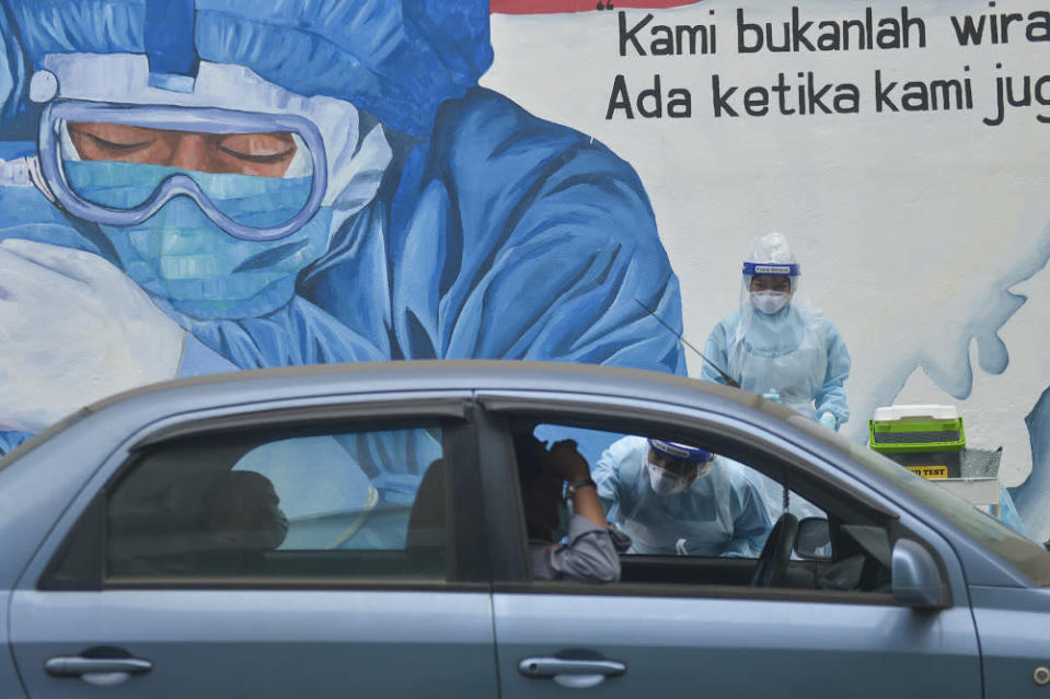 Malaysia ends 2020 with new record high of daily Covid-19 cases. — File picture by Miera Zulyana