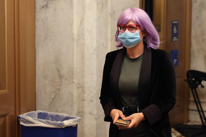 Wearing a face mask to reduce the chance of transmission of the novel coronavirus, Sen. Kyrsten Sinema arrives at the U.S. Capitol for a vote May 18, 2020, in Washington, D.C.