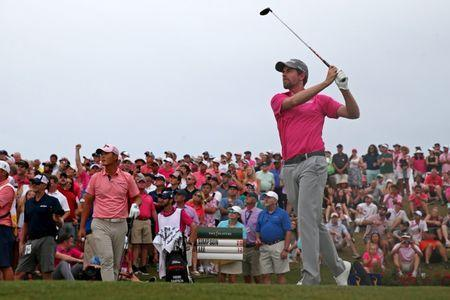 FILE PHOTO: May 13, 2018; Ponte Vedra Beach, FL, USA; Webb Simpson plays his shot from the 18th tee during the final round of The Players Championship golf tournament at TPC Sawgrass - Stadium Course. Mandatory Credit: Peter Casey-USA TODAY Sports