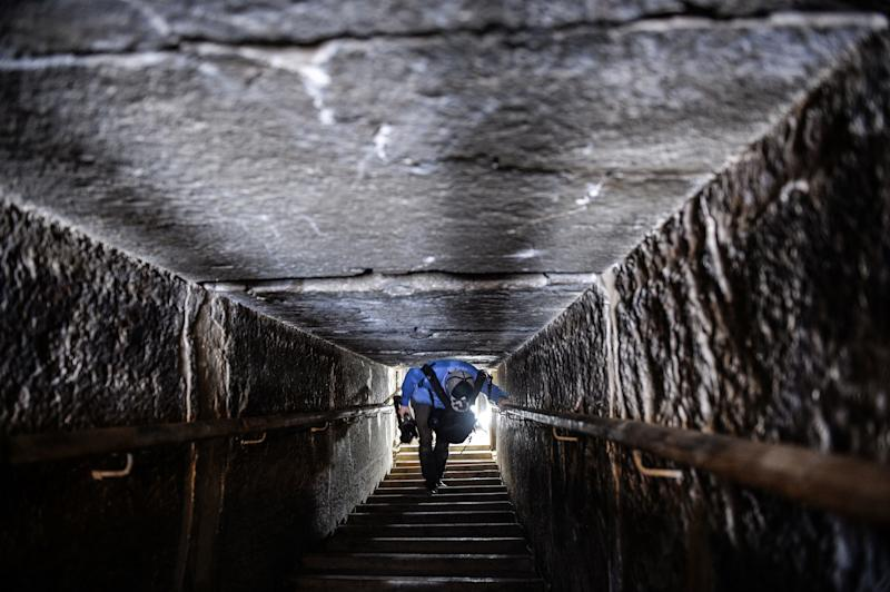 A man walks through a passage in the well-known Bent Pyramid of Sneferu, which had been closed to visitors since 1965.