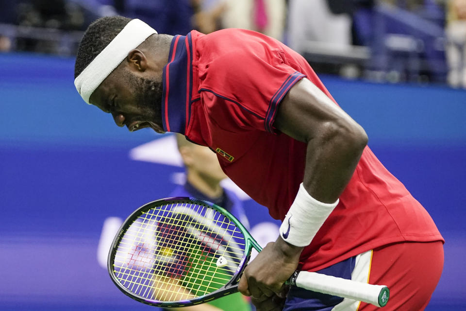 Frances Tiafoe, of the United States, reacts after winning the fourth game of the fourth set against Andrey Rublev, of Russia, at the third round of the US Open tennis championships, Saturday, Sept. 4, 2021, in New York. (AP Photo/Frank Franklin II)