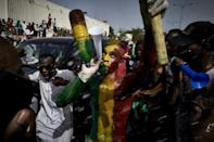 A man painted in the colours of Malian flag at a demonstration last month in Independence Square in Bamako