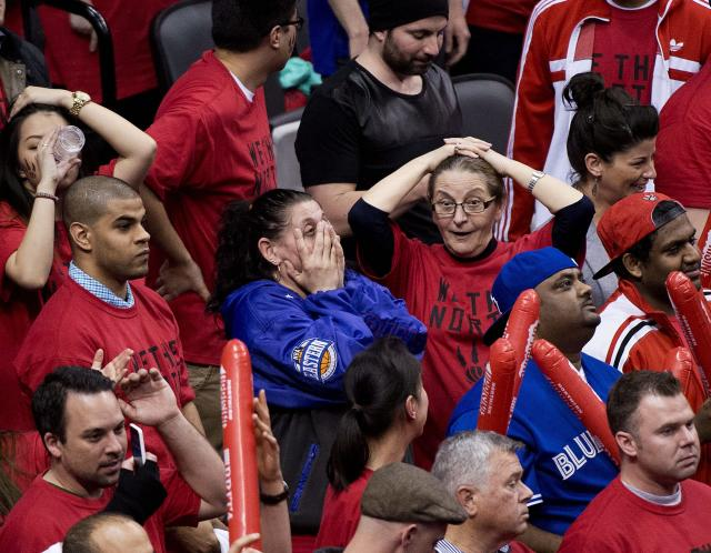Toronto Raptors fans react in the final seconds of the second half of Game 7 of the opening-round NBA basketball playoff series against the Brooklyn Nets in Toronto, Sunday, May 4, 2014. (AP Photo/The Canadian Press, Nathan Denette)