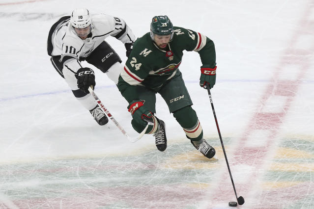 Minnesota Wild's Matt Dumba (24) controls the puck in front of Los Angeles Kings' Tobias Rieder (10) in the first period of an NHL hockey game Monday, March 19, 2018, in St. Paul, Minn. (AP Photo/Stacy Bengs)