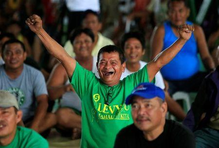 A fan reacts during a televised broadcast of the welterweight boxing match between Manny Pacquiao and Lucas Matthysse, at a gym in Marikina, Metro Manila, Philippines, July 15, 2018. REUTERS/ Czar Dancel