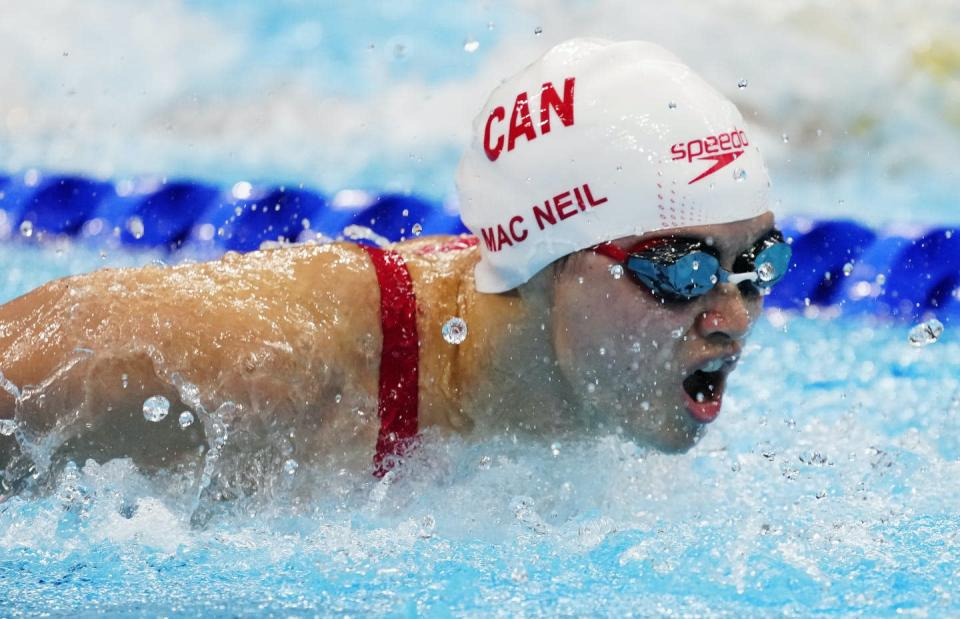 """<span class=""""caption"""">Canada's Margaret Mac Neil swims to a gold medal in the women's 100 metre butterfly final during at the Tokyo Olympics. </span> <span class=""""attribution""""><span class=""""source"""">THE CANADIAN PRESS/Frank Gunn </span></span>"""