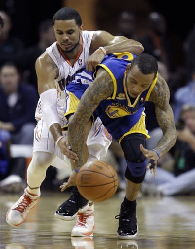 Charlotte Bobcats' D.J. Augustin, rear, battles with Golden State Warriors' Monta Ellis, front, for a loose ball during the first half of an NBA basketball game in Charlotte, N.C., Saturday, Jan. 14, 2012. (AP Photo/Chuck Burton)