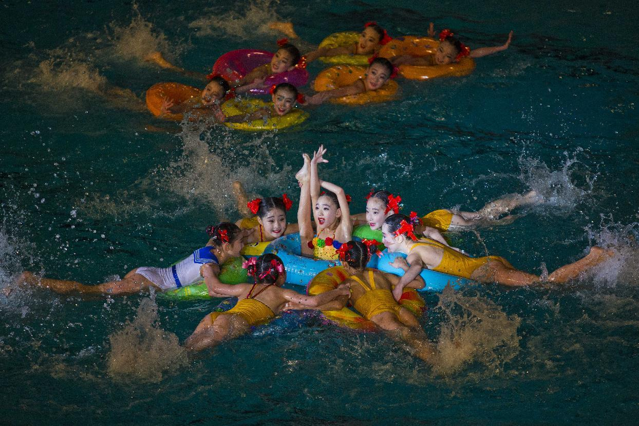 Young North Korean synchronized swimmers perform at an exhibition event in Pyongyang on Friday, Feb. 15, 2013. (AP Photo/David Guttenfelder)