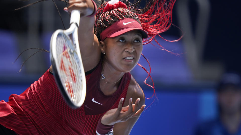 Naomi Osaka spoke with media after her first-round win at the Olympics. (AP Photo/Seth Wenig)