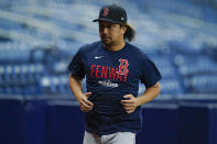 Boston Red Sox pitcher Hirokazu Sawamura runs during the team's AL Division Series baseball practice Wednesday, Oct. 6, 2021, in St. Petersburg, Fla. The Tampa Bay Rays play the Red Sox in the best-of-five series which starts Thursday. (AP Photo/Chris O'Meara)