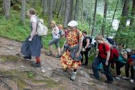 Surrounded by Austria's snow-capped peaks, two dozen spectators hike alongside lay actors who perform scenes based on the real experiences of Holocaust survivors