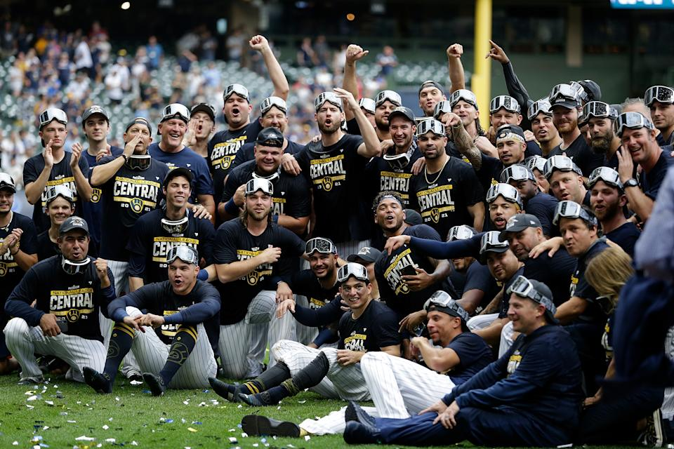 MILWAUKEE, WISCONSIN - SEPTEMBER 26: Milwaukee Brewers celebrates winning the Central Division title after the game against the New York Mets at American Family Field on September 26, 2021 in Milwaukee, Wisconsin. Brewers defeated the Mets 8-4. (Photo by John Fisher/Getty Images)