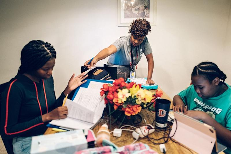 NaShonda Cooke, center, at home in the morning with her daughters in Raleigh, NC.