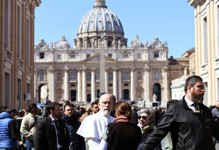 """Gladhanding admirers and greeting babies is one thing for a papal Malkovich -- but repeatedly giving fashion advice to royals is rather a """"nuisance,"""" according to """"The New Pope"""" script (AFP Photo/Vincenzo PINTO)"""