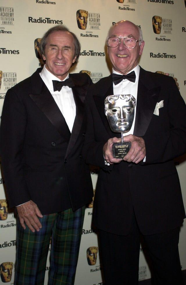 Murray Walker, pictured with three-time world champion Sir Jackie Stewart