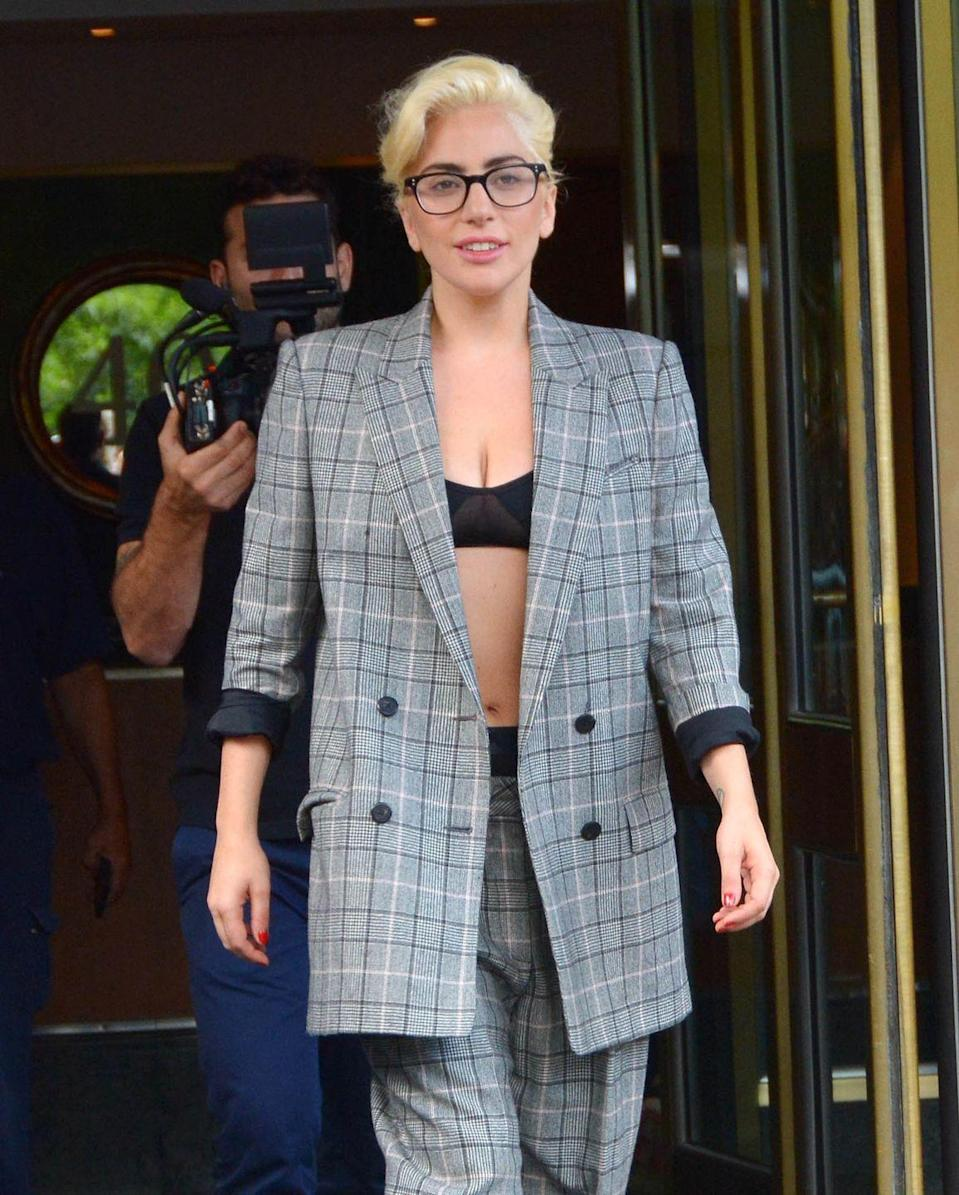 <p>Adorning a simple pair of frames adds to the singer/actress' (relatively) subdued business attire. </p>