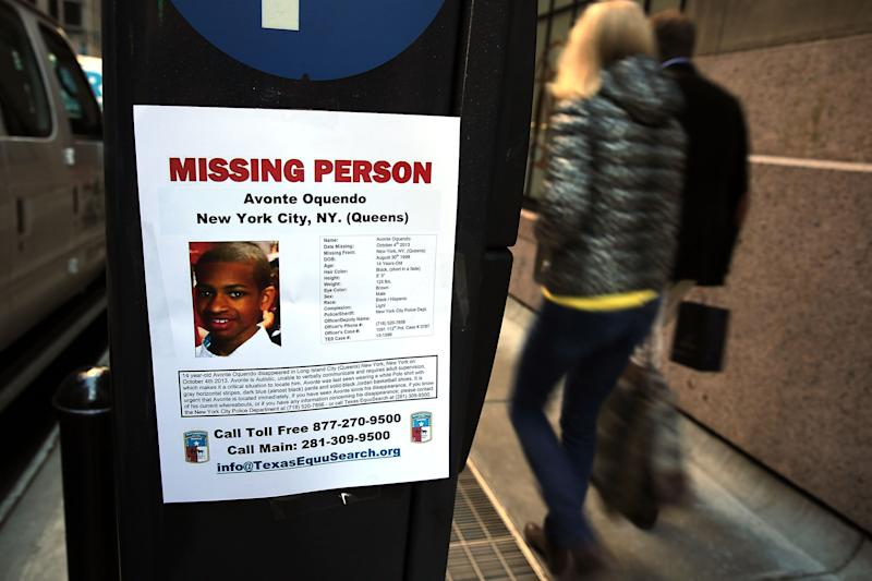 NEW YORK, NY - OCTOBER 21: A missing poster for a missing autistic 14-year-old named Avonte Oquendo, is viewed on a New York City street on October 21, 2013 in New York City. Hundreds of Police, volunteers, friends and family are searching for Avonte who walked out of the Center Boulevard School in Long Island City, Queens on October 4, 2103 and has not been seen since. Family members say that the teen has a fondness for trains and have focused their search along rail yards and in subway stations. (Photo by Spencer Platt/Getty Images)