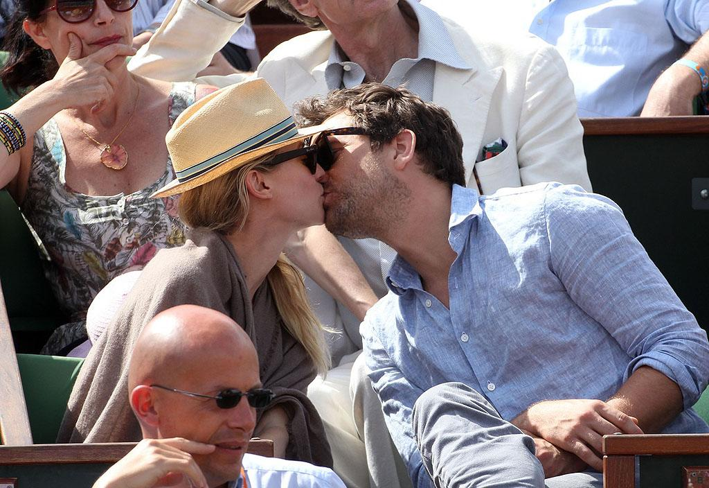 Who knew tennis matches were so romantic! Diane Kruger and her beau Joshua Jackson squeezed in a smooch in between sets during the French Open in Paris on Thursday. (5/31/2012)
