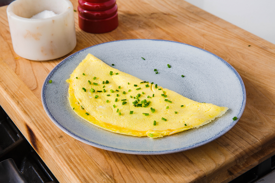 """<p>Add whatever toppings she loves most, but don't skip the cheddar and chives.</p><p>Get the recipe from <a href=""""https://www.delish.com/cooking/recipe-ideas/a24892843/how-to-make-omelet/"""" rel=""""nofollow noopener"""" target=""""_blank"""" data-ylk=""""slk:Delish"""" class=""""link rapid-noclick-resp"""">Delish</a>.</p>"""