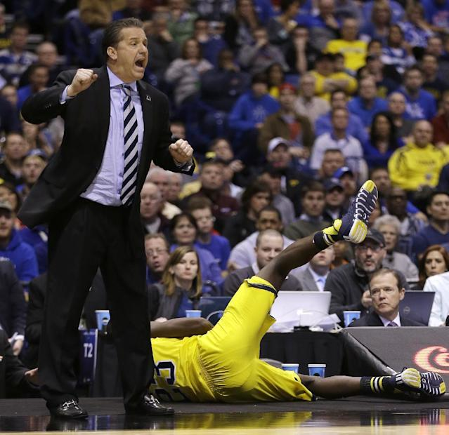 Kentucky head coach John Calipari yells as Michigan's Caris LeVert dives out of bounds during the second half of an NCAA Midwest Regional final college basketball tournament game Sunday, March 30, 2014, in Indianapolis. (AP Photo/David J. Phillip)