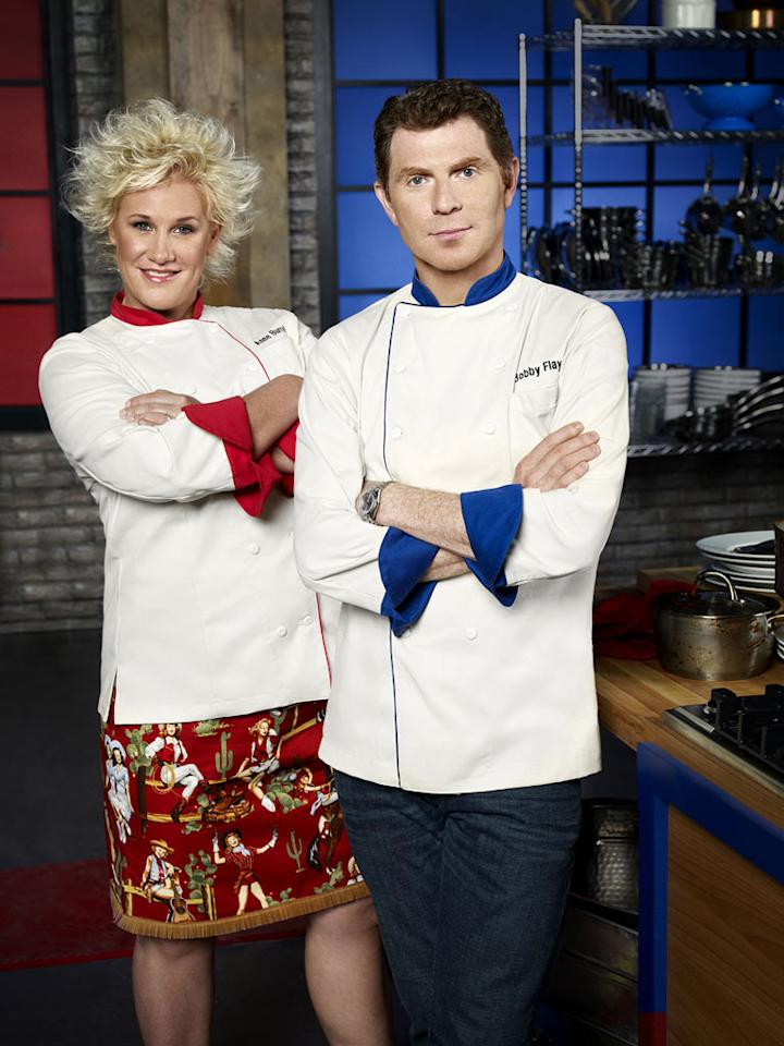 "Hosts Anne Burrell and Bobby Flay on ""Worst Cooks in America."""