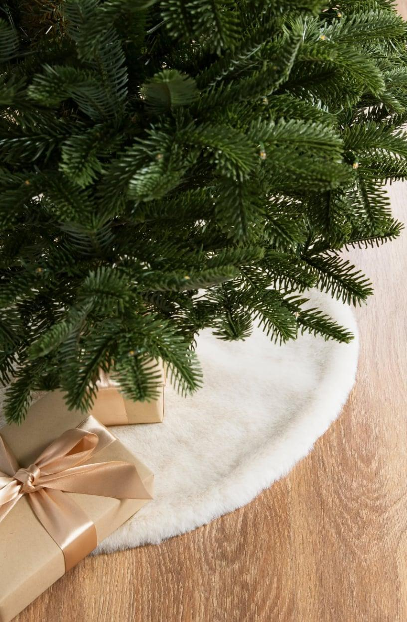 <p>Come Christmas Day, the bottom of your tree will be adorned with gifts. However, if you want to keep your setup looking its best before December 25, this <span>Balsam Hill Lodge Faux Fur Tree Skirt</span> ($129) won't disappoint.</p>