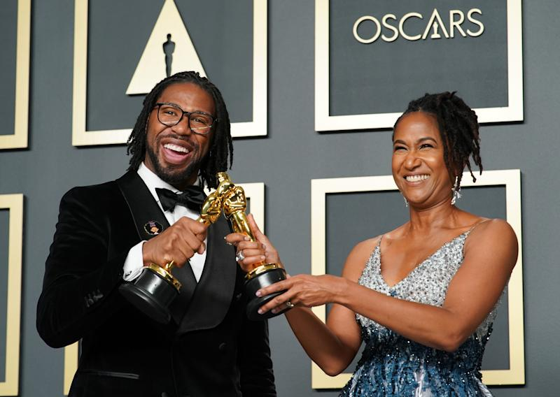 "HOLLYWOOD, CALIFORNIA - FEBRUARY 09: (L-R) Matthew A. Cherry and Karen Rupert Toliver, winners of the Animated Short Film award for ""Hair Love,"" pose in the press room during the 92nd Annual Academy Awards at Hollywood and Highland on February 09, 2020 in Hollywood, California. (Photo by Rachel Luna/Getty Images)"