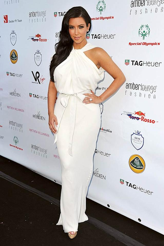 "Paris' former BFF Kim Kardashian showed off her signature curves in a belted white halter dress at a Matthew Williamson fashion show in Monaco on Monday afternoon. More importantly, the reality star accessorized with her new engagement ring -- a dazzling 20.5-carat rock -- gifted to her by her fiance, pro basketball player Kris Humphries. Pascal Le Segretain/<a href=""http://www.gettyimages.com/"" target=""new"">GettyImages.com</a> - May 27, 2011"