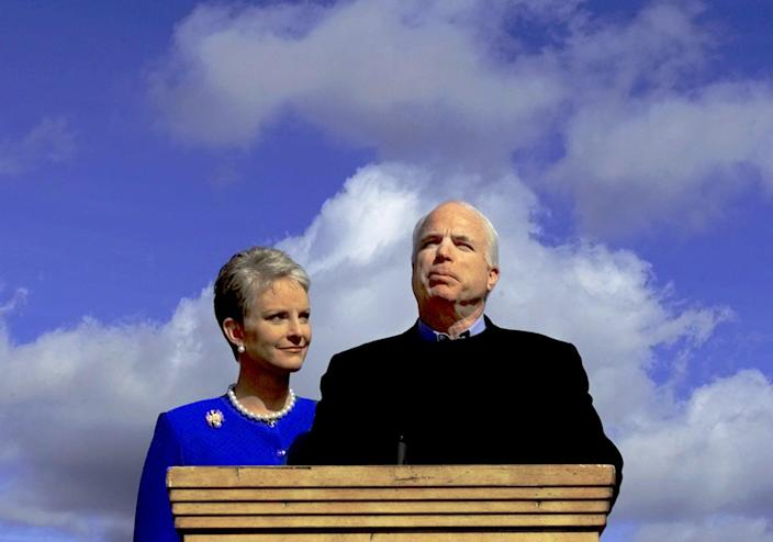 """McCain announced that he was suspending his bid for the GOP presidential nomination on March 9, 2000, in Sedona, Ariz., as his wife, Cindy, looks on. """"I'm older than dirt, more scars than Frankenstein, but I learned a few things along the way,"""" McCain has said. (Photo: Matt York/AP)"""
