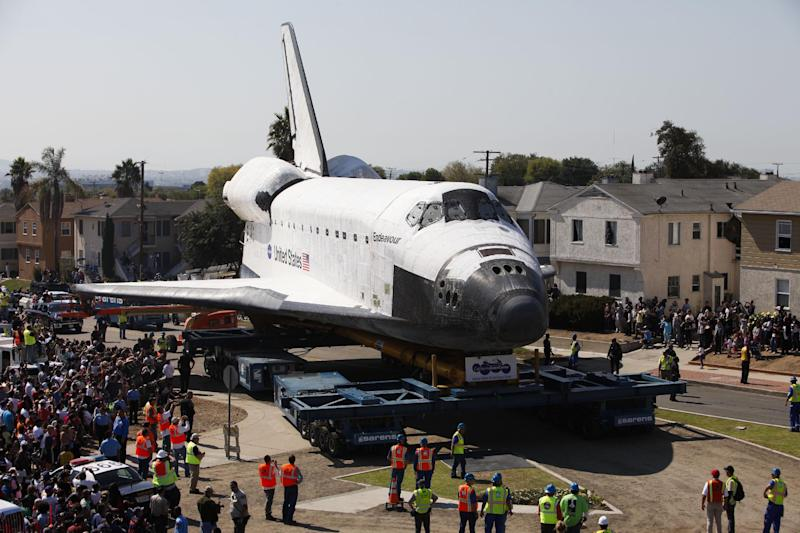 Spectators take pictures as the space shuttle Endeavour makes its way through city streets in Inglewood, Calif., Saturday, Oct. 13, 2012. Endeavour's 12-mile road trip kicked off shortly before midnight Thursday as it moved from its Los Angeles International Airport hangar en route to the California Science Center. (AP Photo/Patrick T. Fallon)