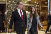 """FILE — In this Jan. 18, 2017 file photo, New York Gov. Andrew Cuomo, accompanied by his chief of staff Melissa DeRosa, walks to talk with members of the media after meeting with President-elect Donald Trump at Trump Tower in New York. De Rosa, Cuomo's top aide, told top Democrats frustrated with the administration's long-delayed release of data about nursing home deaths that the administration """"froze"""" over worries about what information was """"going to be used against us,"""" according to a Democratic lawmaker who attended the Wednesday, Feb. 10, 2021 meeting and a partial transcript provided by the governor's office. (AP Photo/Andrew Harnik, File)"""