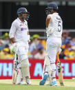 India's Shardul Thakur, left, and teammate Washington Sundar talk during play on day three of the fourth cricket test between India and Australia at the Gabba, Brisbane, Australia, Sunday, Jan. 17, 2021. (AP Photo/Tertius Pickard)