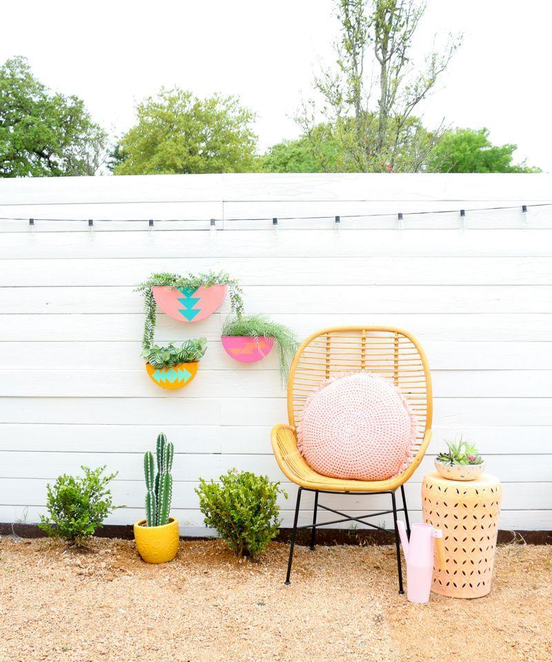"""<p>To bring a pop of color to your garden or patio, craft these patterned wall planters painted in bold hues. </p><p><strong>Get the tutorial at <a href=""""https://akailochiclife.com/2019/05/diy-colorful-outdoor-wall-planters.html"""" rel=""""nofollow noopener"""" target=""""_blank"""" data-ylk=""""slk:A Kailo Chic Life"""" class=""""link rapid-noclick-resp"""">A Kailo Chic Life</a>.</strong></p><p><a class=""""link rapid-noclick-resp"""" href=""""https://go.redirectingat.com?id=74968X1596630&url=https%3A%2F%2Fwww.walmart.com%2Fip%2FAssorted-Super-Value-Brush-Set-Synthetic-and-Natural-Hair-25-Piece%2F193840762&sref=https%3A%2F%2Fwww.thepioneerwoman.com%2Fhome-lifestyle%2Fgardening%2Fg36556911%2Fdiy-planters%2F"""" rel=""""nofollow noopener"""" target=""""_blank"""" data-ylk=""""slk:SHOP PAINT BRUSHES"""">SHOP PAINT BRUSHES</a></p>"""