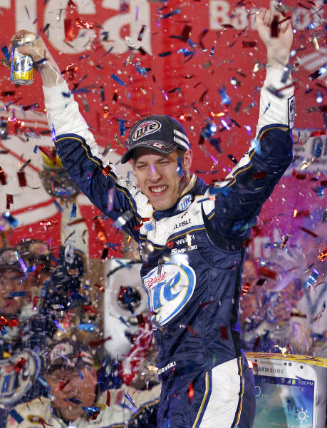 Brad Keselowski celebrates in Victory Lane after winning the NASCAR Sprint Cup Series auto race at Charlotte Motor Speedway in Concord, N.C., Saturday, Oct. 12, 2013. (AP Photo/Terry Renna)