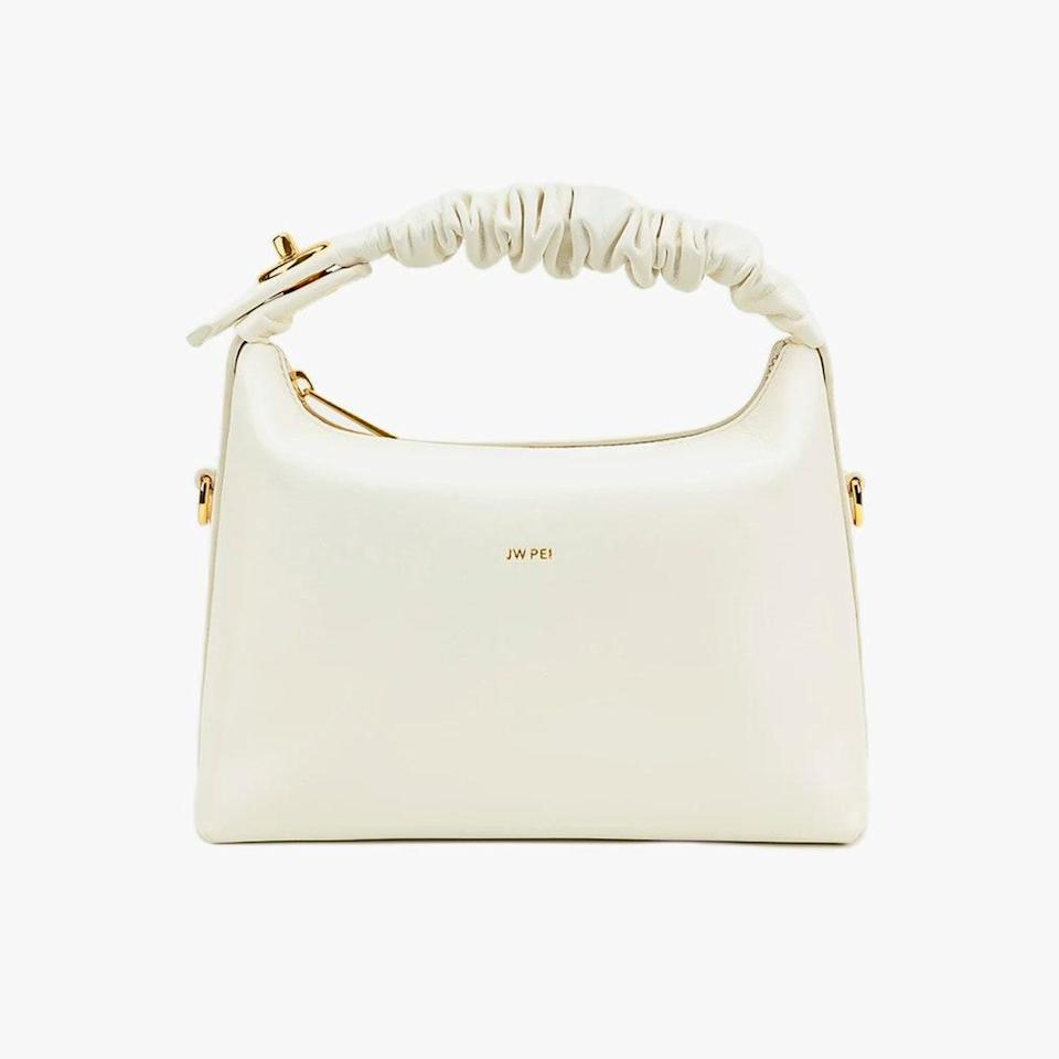 """$89, JW PEI. <a href=""""https://www.jwpei.com/collections/crossbody/products/cora-top-handle-bag-white"""" rel=""""nofollow noopener"""" target=""""_blank"""" data-ylk=""""slk:Get it now!"""" class=""""link rapid-noclick-resp"""">Get it now!</a>"""