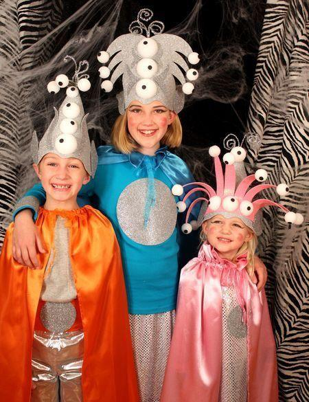 """<p>How cute are these little aliens? Lots of styrofoam eyeballs, metallic glitter foam, and capes make up these colorful and easy DIY costumes. </p><p><strong>Get the tutorial at <a href=""""https://7layerstudio.typepad.com/7_layer_studio/2011/10/falling-for-fall.html"""" rel=""""nofollow noopener"""" target=""""_blank"""" data-ylk=""""slk:7 Layer Studio"""" class=""""link rapid-noclick-resp"""">7 Layer Studio</a>.</strong></p><p><a class=""""link rapid-noclick-resp"""" href=""""https://www.amazon.com/Allgala-Glitter-Paper-12inch-Sheets-Silver-CF85002/dp/B07JDH9T2Y/ref=sr_1_3?tag=syn-yahoo-20&ascsubtag=%5Bartid%7C10050.g.28496790%5Bsrc%7Cyahoo-us"""" rel=""""nofollow noopener"""" target=""""_blank"""" data-ylk=""""slk:SHOP GLITTER FOAM SHEETS"""">SHOP GLITTER FOAM SHEETS</a> </p>"""