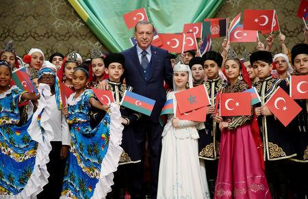 Turkish President Erdogan poses with visiting children at the Presidential Palace in Ankara